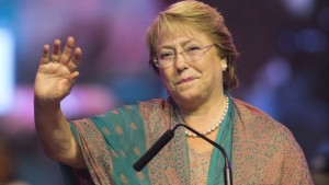 Presidential candidate Michelle Bachelet waves at her closing campaign rally in Santiago, Chile, Thursday, Nov. 14, 2013. Bachelet is expected to overwhelmingly win Sunday's presidential election and possibly avoid a runoff. Thursday was the last day of campaigning for elections that will also choose 120 members of the lower House of Congress and 20 out of 38 Senate seats. (AP Photo/Victor Caivano)